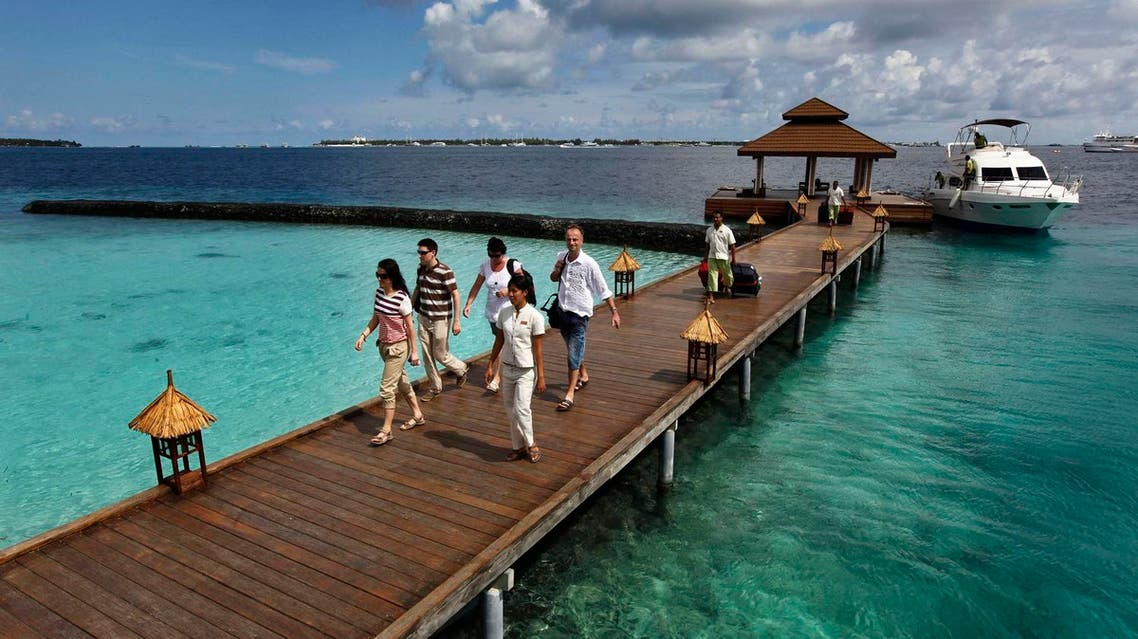 In this Feb. 12, 2012 file photo, foreign tourists arrive in a resort in the Kurumba island in Maldives. (AP)