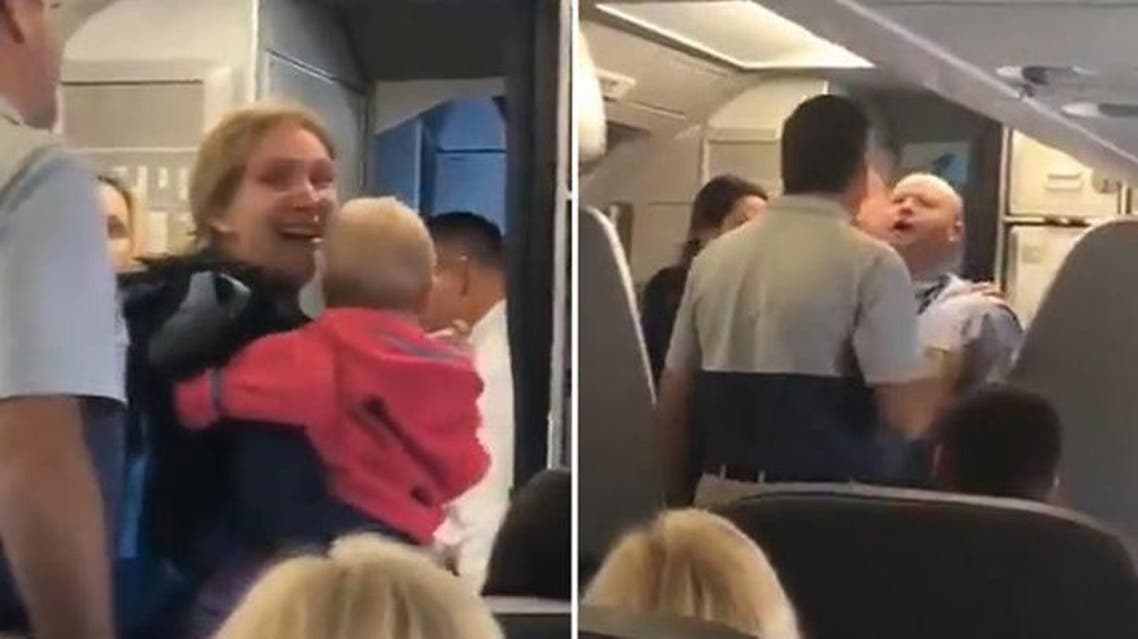 The viral video, filmed by another passenger, shows a distraught mother carrying her baby boarding the plane. (Screengrab)