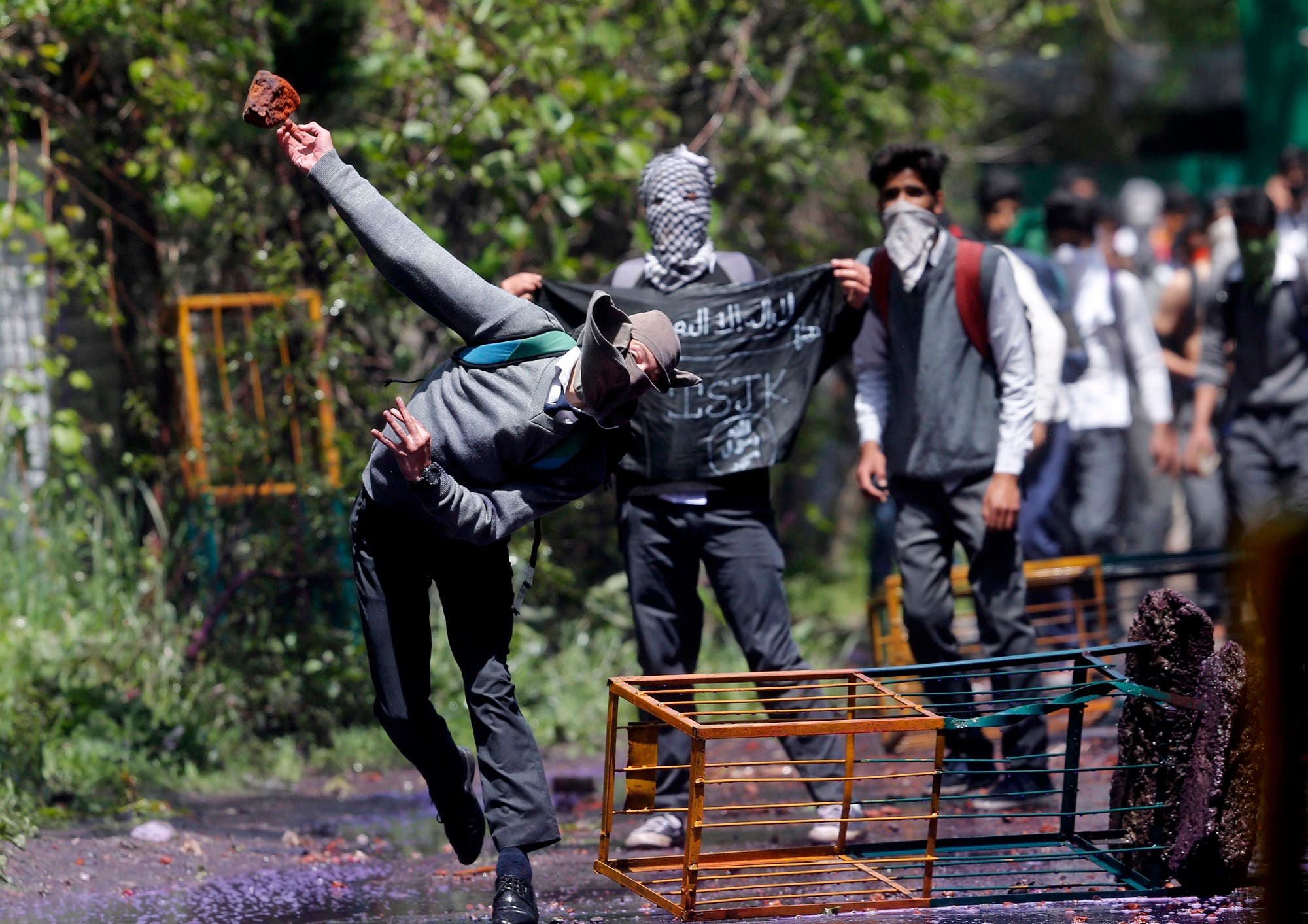 A Kashmiri student throws a brick at police as they clash in Srinagar, Indian controlled Kashmir, Monday, April 24, 2017. (AP)