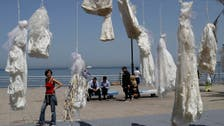 IN PICTURES: Wedding dresses hang in Beirut seafront protest against rape laws
