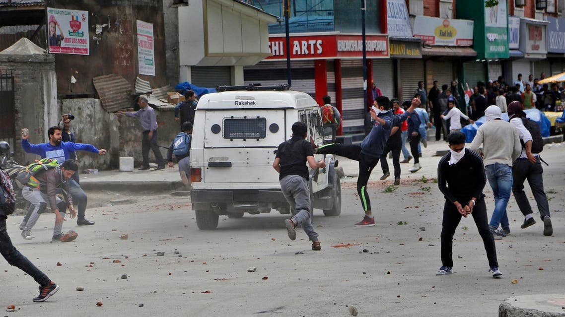 Kashmiri students and other protesters throw stones at an Indian police vehicle as they clash with police in Srinagar, Indian controlled Kashmir, Monday, April 24, 2017. (AP)
