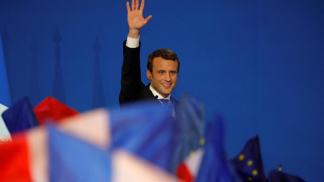 Emmanuel Macron, head of the political movement En Marche !, or Onwards !, and candidate for the 2017 French presidential election, waves to supporters after the first round of 2017 French presidential election in Paris, France, April 23, 2017