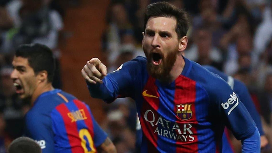 Barcelona's Lionel Messi celebrates scoring their third goal. (Reuters)