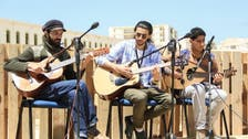 Libyans in Benghazi are arming themselves with music, literature