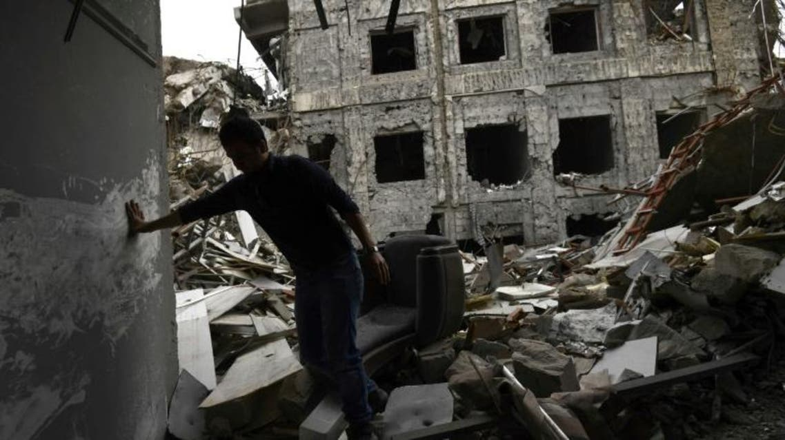 An Iraqi volunteer walks amid the rubble of the destroyed buildings of Mosul's University in east of Mosul as he looks for documents that may have survived, on April 13, 2017. (AFP)