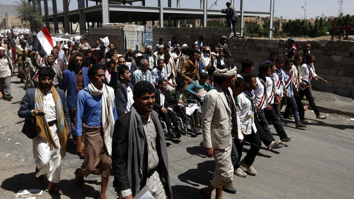 """Yemeni men take part in a """"protest for bread"""" march from the capital Sanaa to the coastal town of Hodeida on April 19, 2017. (AFP)"""