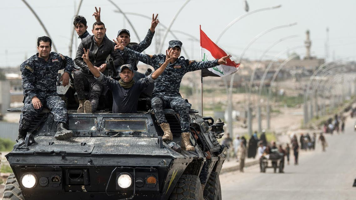 raqi forces continue the offensive to retake the city from ISIS group fighters.