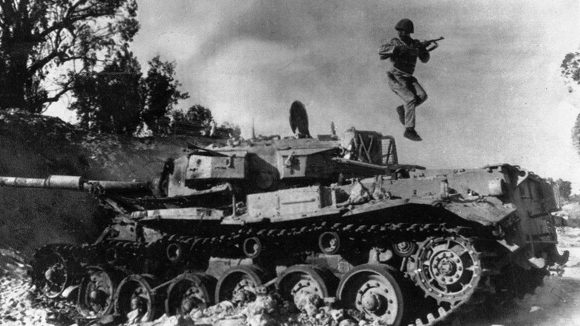 An Egyptian soldier jumps out of a disabled Israeli tank on the Sinai desert after inspecting it, Oct. 24, 1973 (File Photo: AP)