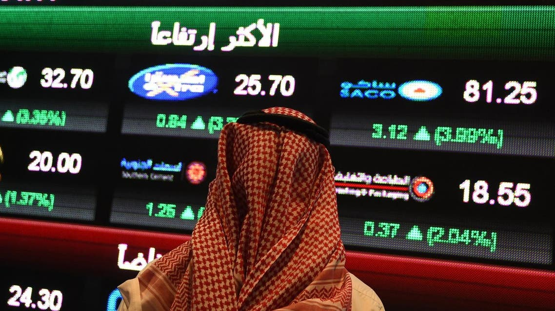 A Saudi investor monitors the stock exchange at the Saudi Stock Exchange, or Tadawul, on December 14, 2016 in the capital Riyadh. (AFP)