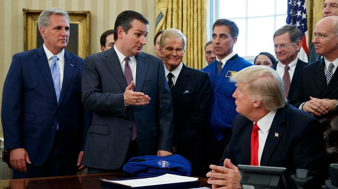 Sen. Ted Cruz, R-Texas, accompanied by, from left, House Majority Leader Kevin McCarthy of Calif., Sen. Marco Rubio, R-Fla., and Sen. Bill Nelson, D-Fla. speaks in the Oval Office of the White House in Washington, Tuesday, March 21, 2017, during a bill signing by the president to increase NASA's budget to $19.5 billion and directs the agency to focus human exploration of deep space and Mars. (AP Photo/Evan Vucci)