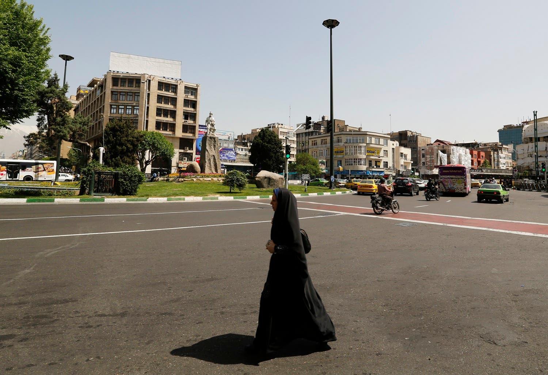 An Iranian woman crosses a street in the capital Tehran on April 23, 2017. (AFP)