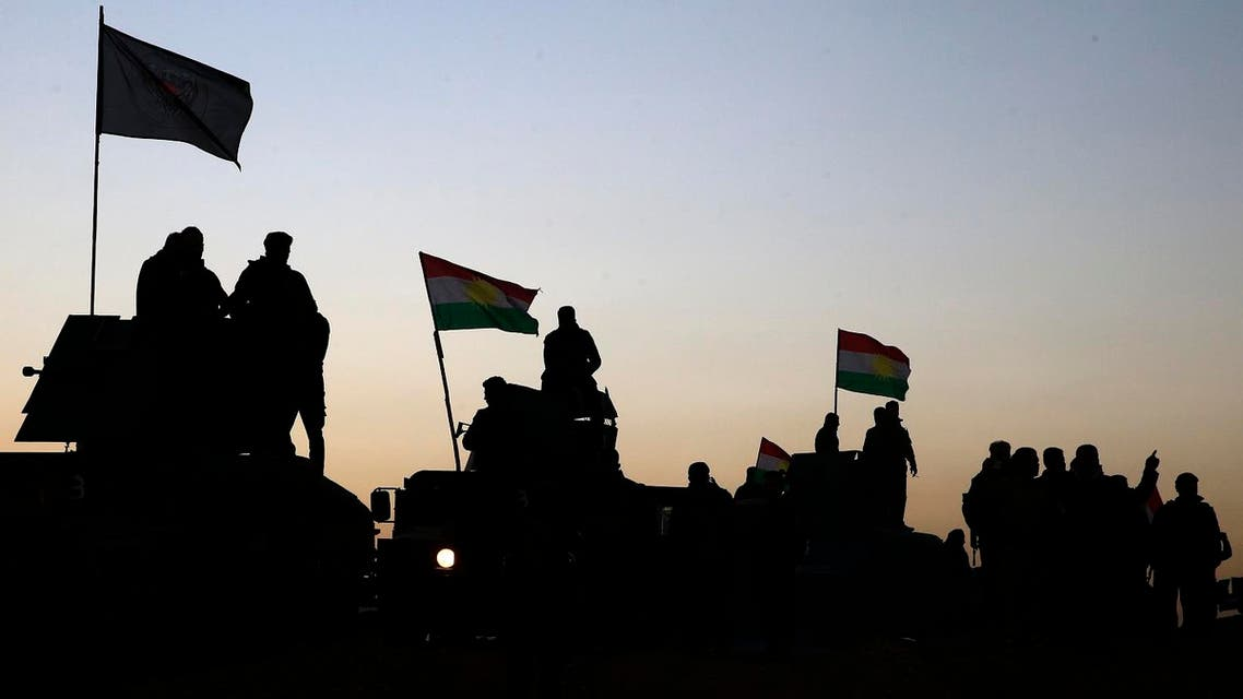 Kurdish Peshmerga fighters stand on top of a military vehicle as they advance towards villages surrounding Mosul. (File photo: AP)