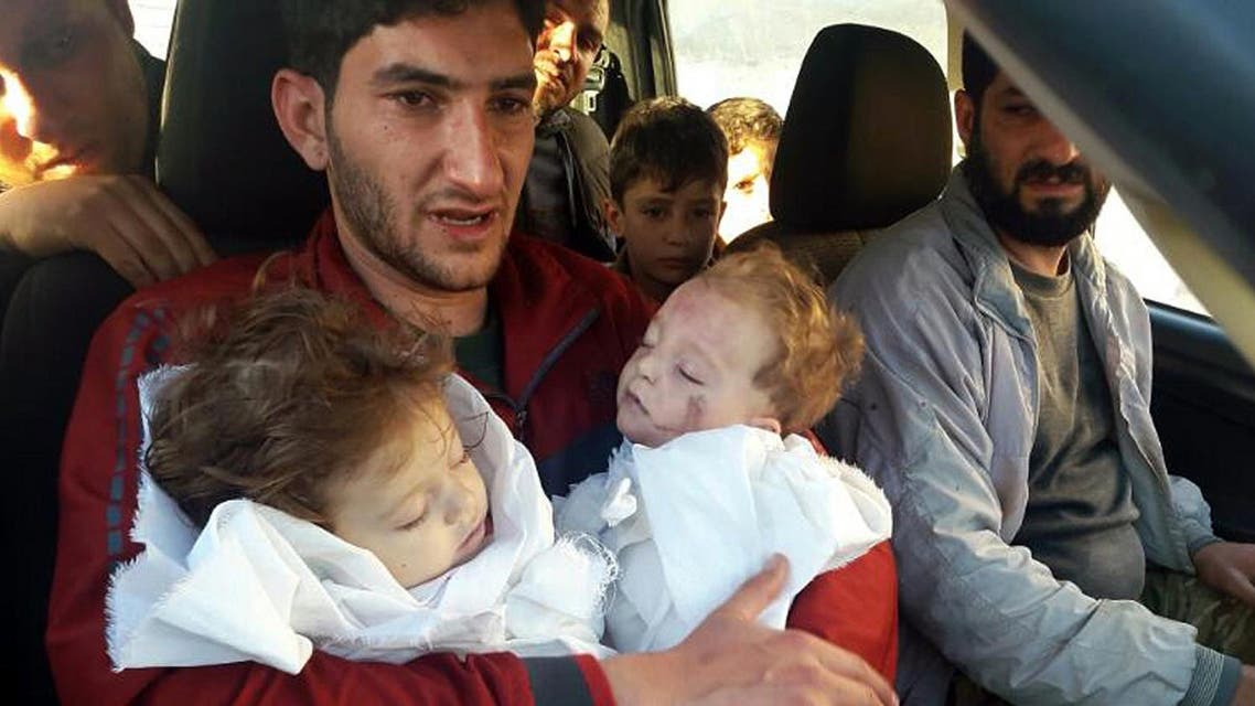In this Tuesday April 4, 2017 file photo, Abdel Hameed Alyousef, 29, holds his twin babies who were killed during a suspected chemical weapons attack, in Khan Sheikhoun in the northern province of Idlib, Syria (File Photo: Alaa Alyousef via AP)