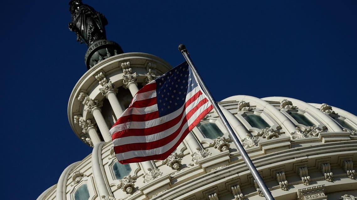 An American flag waves outside the US Capitol building as Congress remains gridlocked over legislation to continue funding the federal government September 29, 2013 in Washington, DC. (AFP)