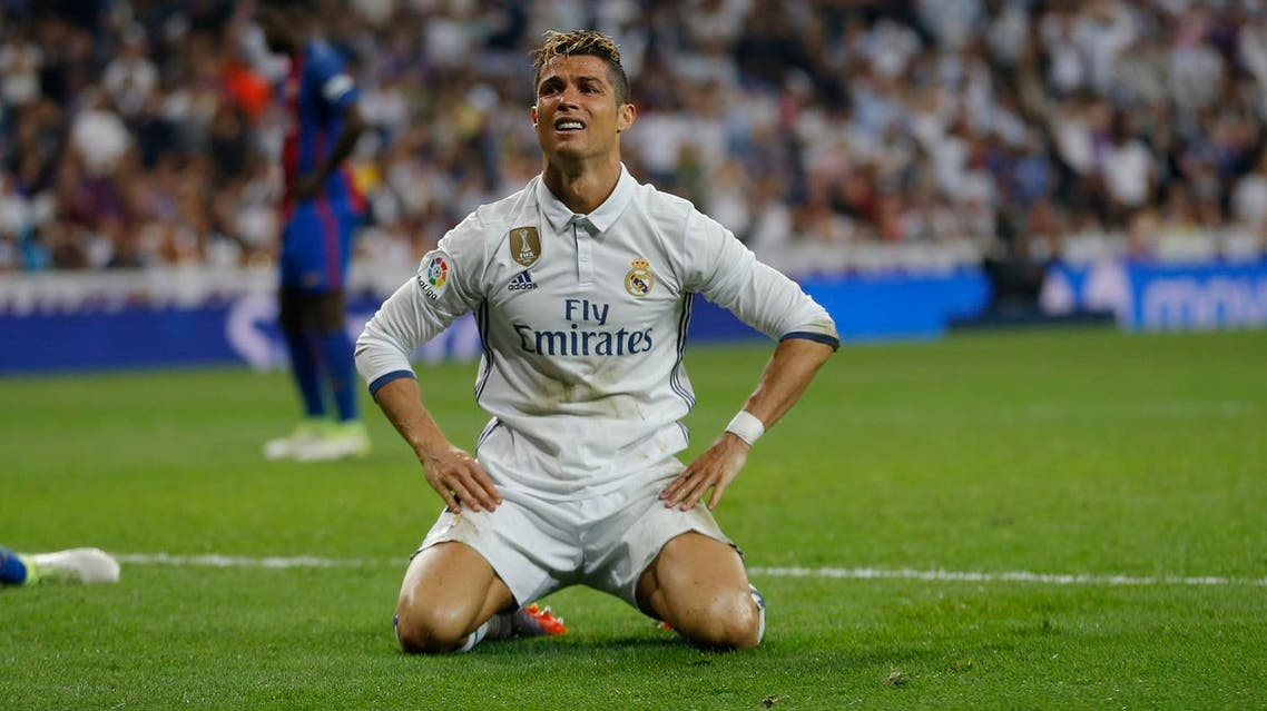 Real Madrid's Cristiano Ronaldo grimaces after missing a scoring chance during a Spanish La Liga soccer match between Real Madrid and Barcelona, dubbed 'el clasico', at the Santiago Bernabeu stadium in Madrid, Spain, Sunday, April 23, 2017. (AP Photo/Francisco Seco)