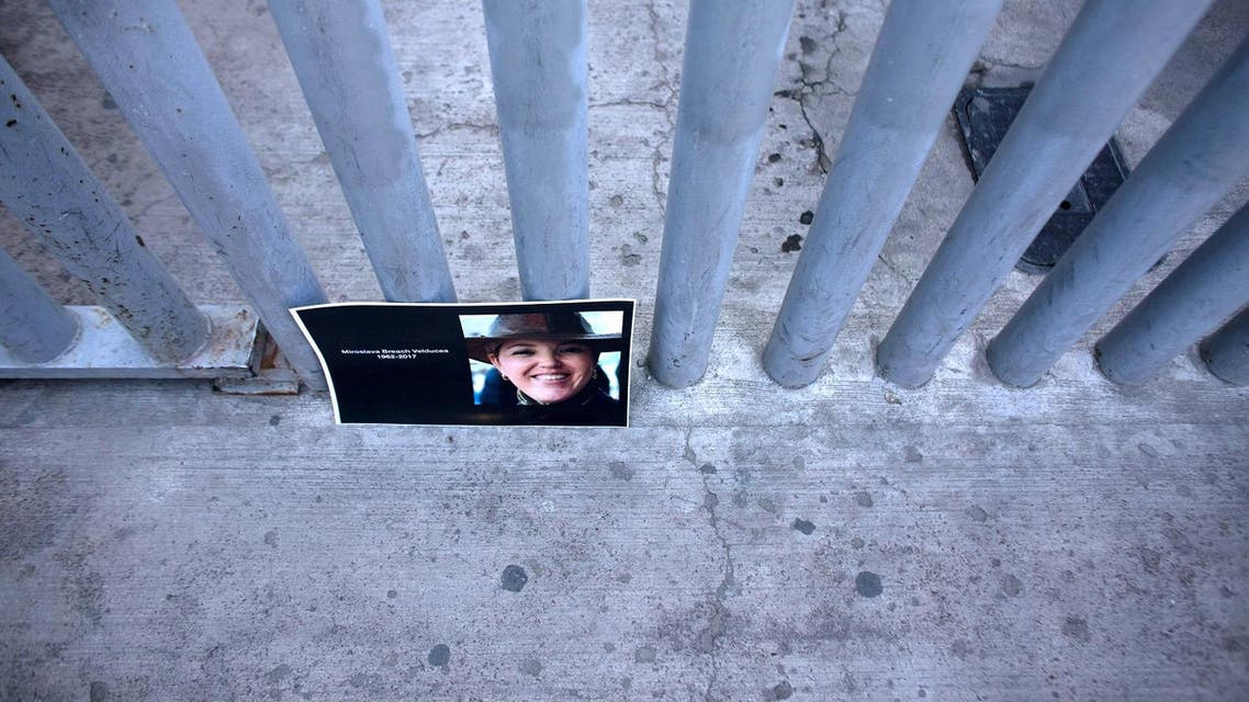 A picture of recently murdered journalist Miroslava Breach, of La Jornada newspaper, is seen outside the Attorney General of the Republic building during a demonstration against violence targeting reporters in Tijuana, Mexico on March 29, 2017. (AFP)