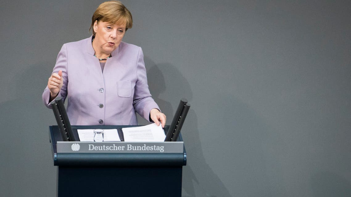 """German Chancellor Angela Merkel delivers a speech on Europe at the Bundestag, the German lower house of parliament ahead of a EU summit in Brussels on April 27, 2017 in Berlin. German Chancellor Angela Merkel on Thursday told Britain not to have any """"illusions"""" that it would have the same rights as an EU member after it leaves the bloc. ميركل تتحدث قبل قمة أوروبية 27-4-2017"""