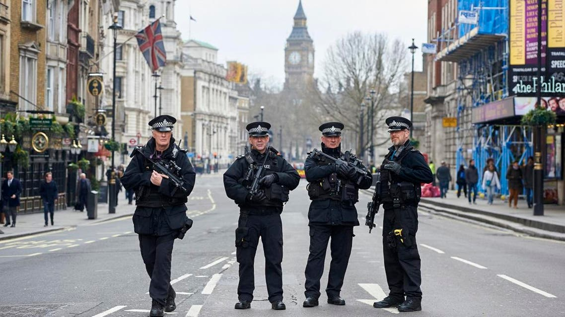 Armed police officers secure the area on Whitehall leading toward the Houses of Parliament in central London on March 23, 2017. (AFP)