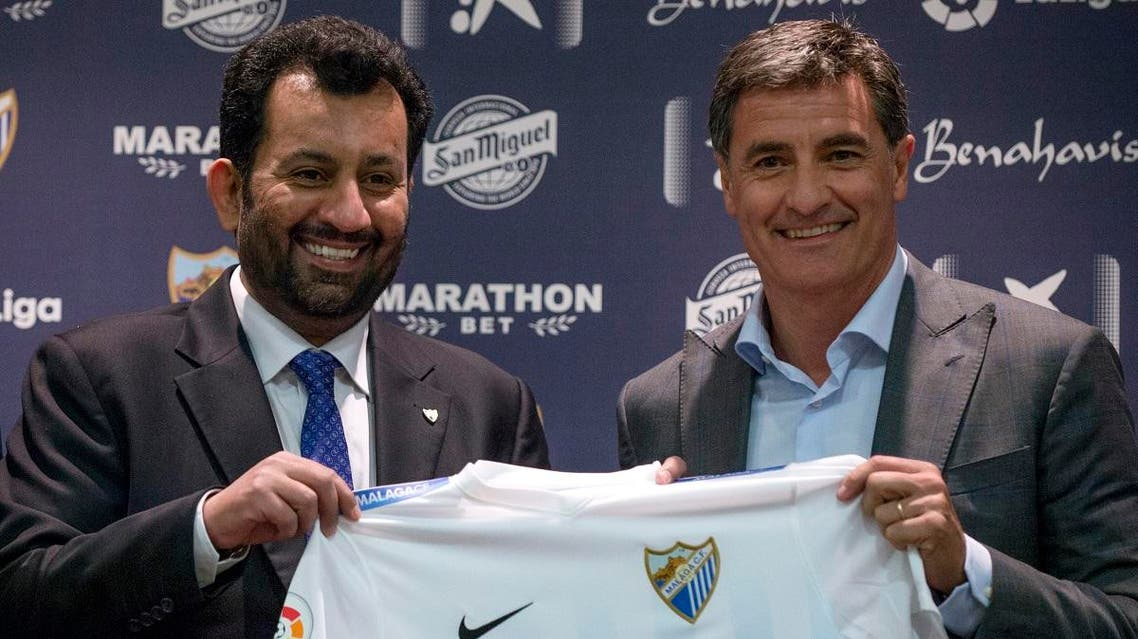Malaga's new coach Jose Miguel Gonzalez Martin del Campo aka Michel (R) poses with Malaga CF's chairman Sheikh Abdallah Ben Nasser Al-Thani during his official presentation at the Rosaleda stadium in Malaga, on March 8, 2017. (AFP)