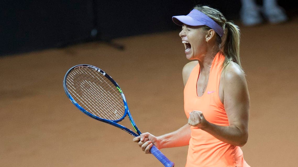 Russia's Maria Sharapova reacts after defeating Italy's Roberta Vinci in their first round match at the WTA tennis Grand Prix in Stuttgart, southwestern Germany, on April 26, 2017. (AFP)