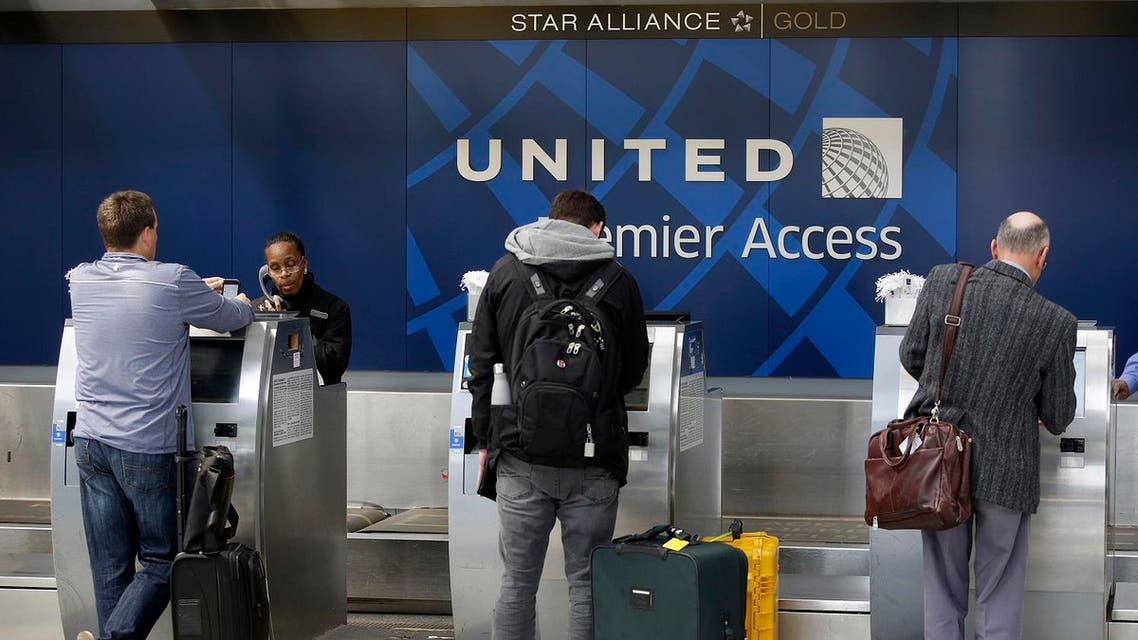 Travelers check-in at the United Airlines Premier Access at O'Hare International Airport on April 12, 2017 in Chicago, Illinois. United Airlines has been criticized in recent days after airport police officers physically removed passenger Dr. David Dao from his seat and dragged him off the airplane, after he was requested to give up his seat for United Airline crew members on a flight from Chicago to Louisville, Kentucky Sunday night. (AFP)