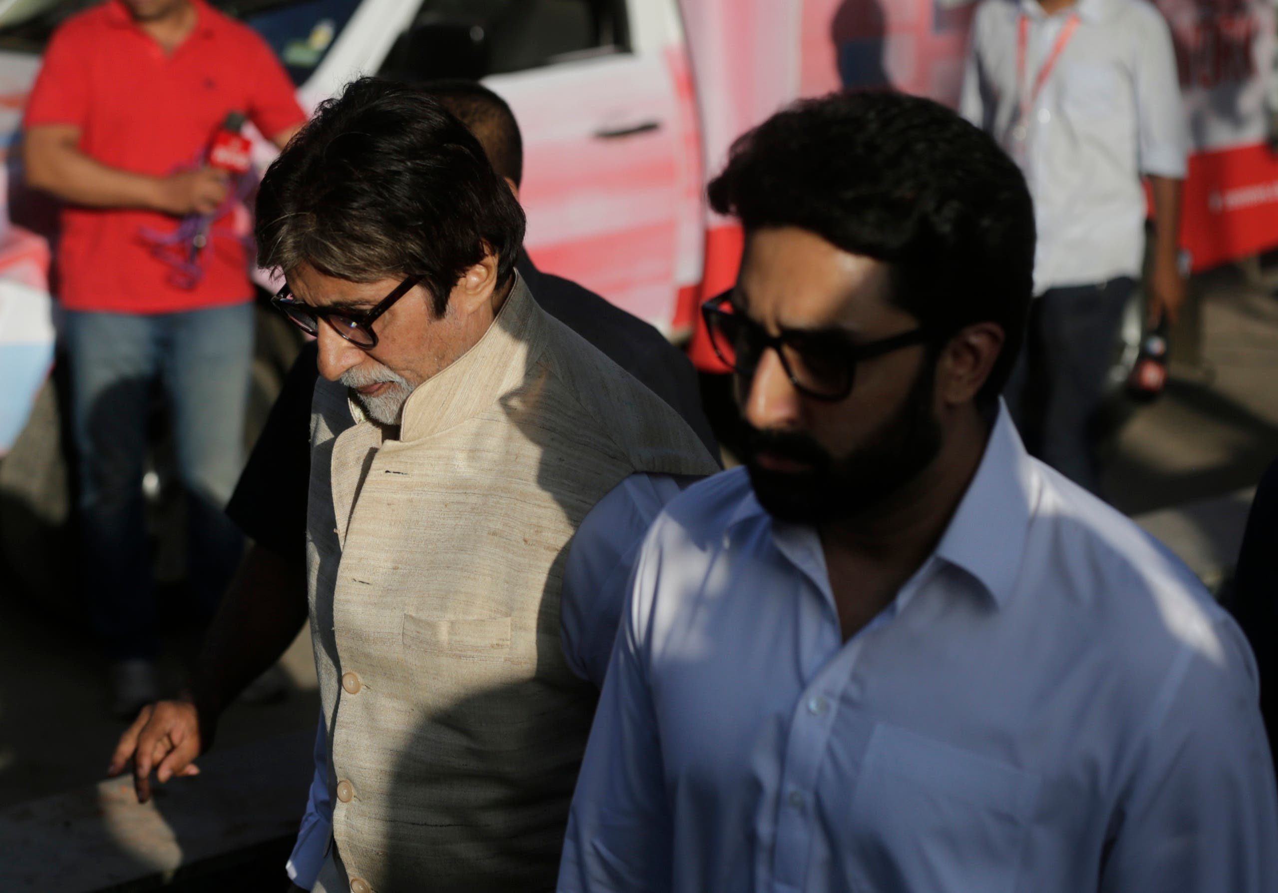 Bollywood actor Amitabh Bachchan and his son Abhishek Bachchan arrive to attend the funeral of Vinod Khanna in Mumbai on April 27, 2017. (AP)