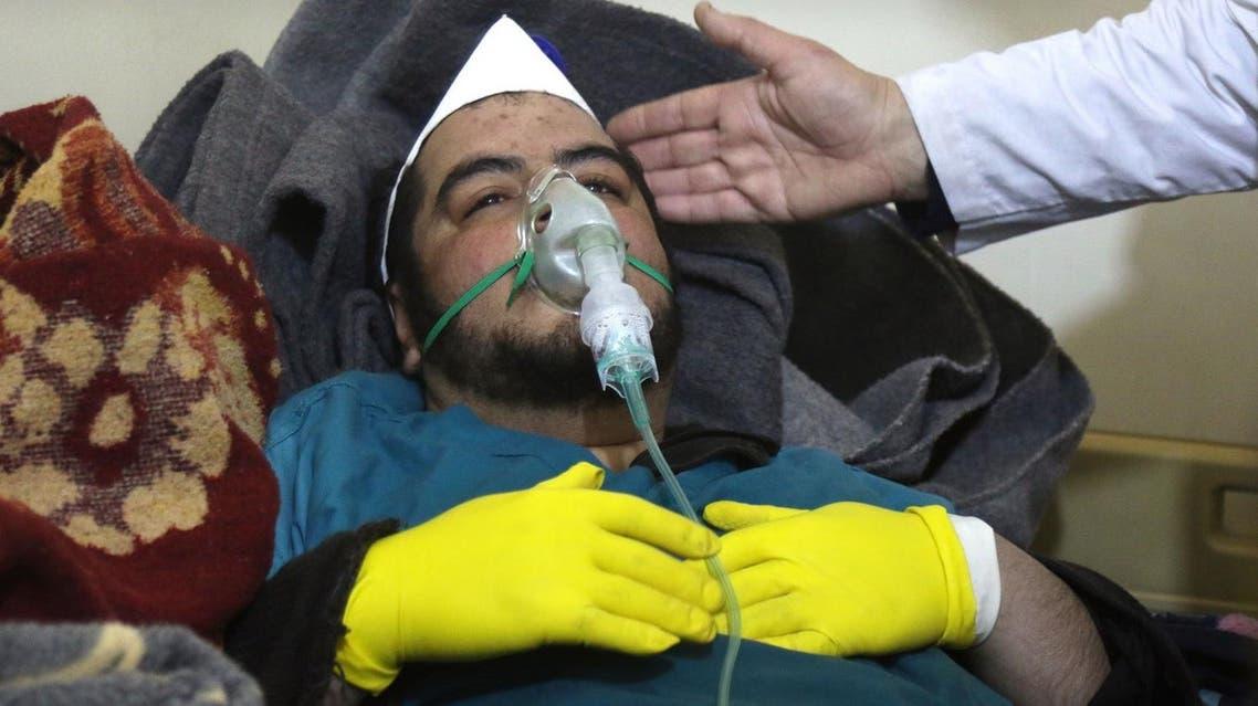 A Syrian man receives treatment at a small hospital in the town of Maaret al-Noman following a suspected toxic gas attack in Khan Sheikhun, a nearby rebel-held town in Syria's northwestern Idlib province, on April 4, 2017. Warplanes carried out a suspected toxic gas attack that killed at least 35 people including several children, a monitoring group said. The Syrian Observatory for Human Rights said those killed in the town of Khan Sheikhun, in Idlib province, had died from the effects of the gas, adding that dozens more suffered respiratory problems and other symptoms. (AFP)
