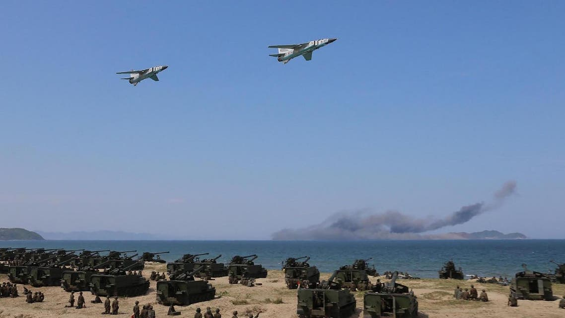 This undated picture released by North Korea's official news agency on April 26, 2017 shows the combined fire demonstration of the services of the Korean People's Army in celebration of its 85th founding anniversary at the airport of eastern front. (AFP)