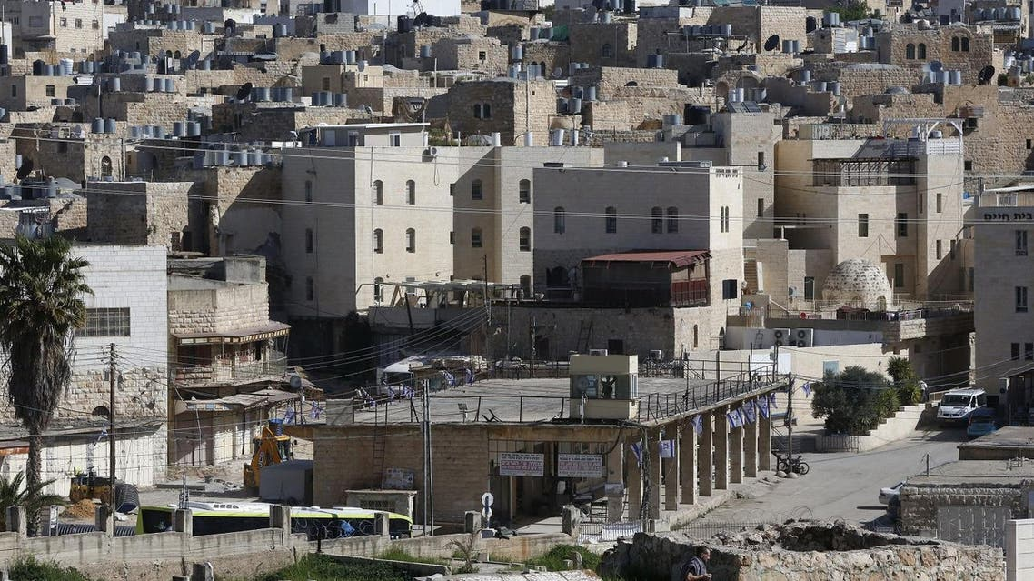 A picture taken on April 6, 2017 shows a general view of the Israeli settlement of Abraham Avino (back) in the centre of the Old City of the Palestinian city of Hebron (bottom) in the occupied West Bank.  (AFP)