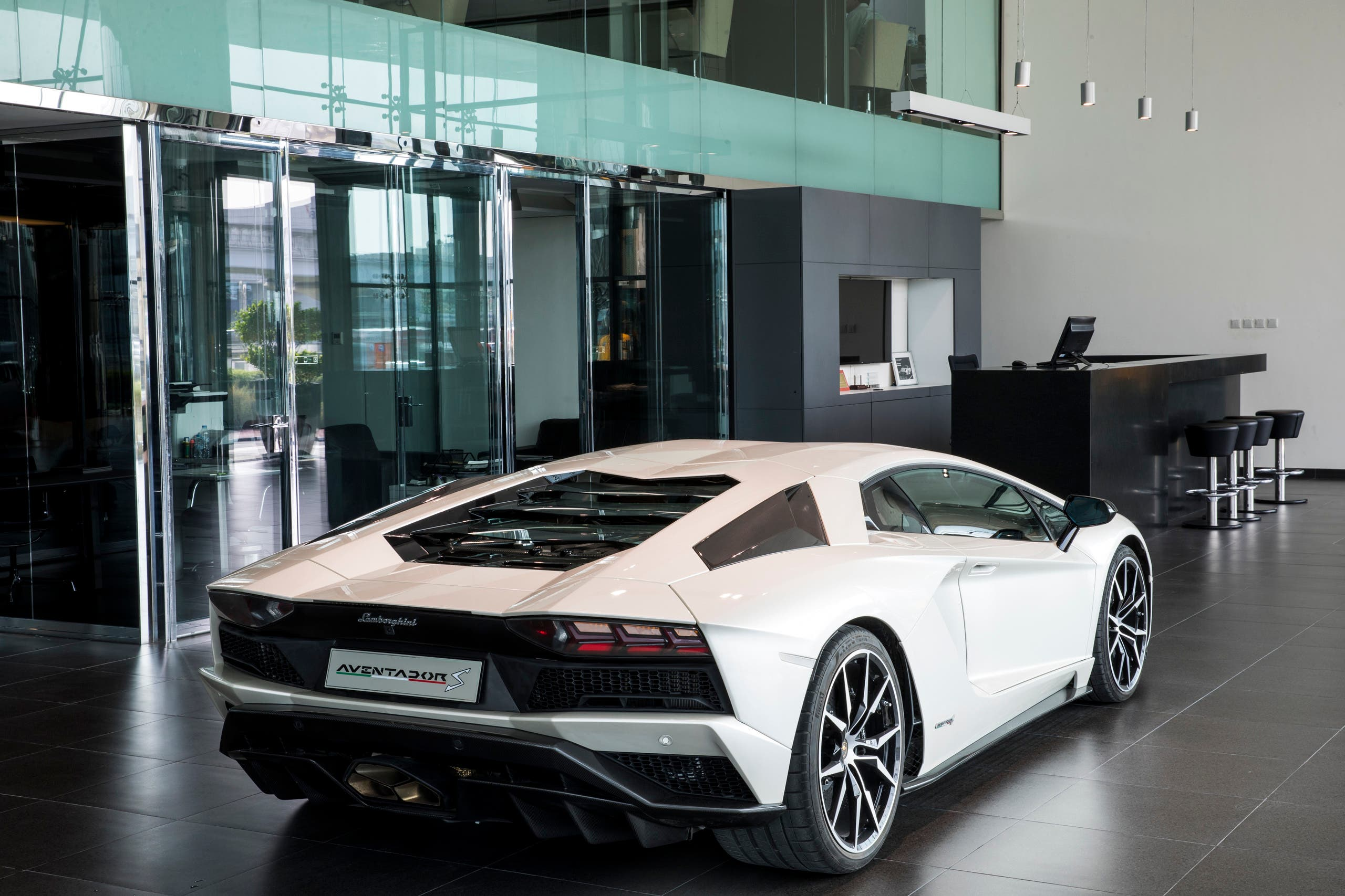 According to the description by the architect the lamborghini showroom and offices building reflects and emphasizes the spirit of this exclusive