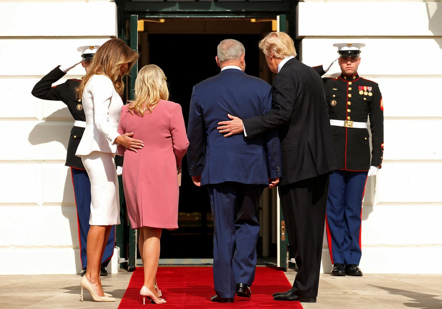 US President Donald Trump (R) and first lady Melania Trump (L) greet Israeli Prime Minister Benjamin Netanyahu and his wife Sara as they arrive at the South Portico of the White House, February 15, 2017 (Photo: Reuters/Kevin Lamarque)