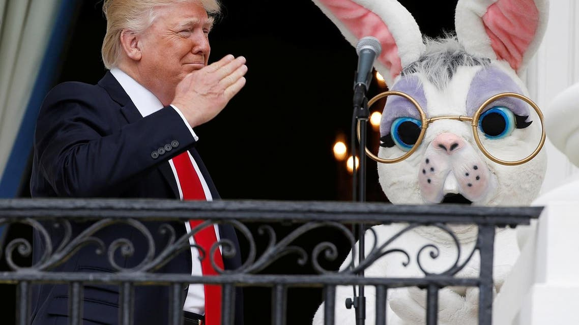 Trump salutes a member of the military (not seen in photo) who had just sung the US national anthem as he stands with a performer in an Easter Bunny costume at the White House Easter Egg Roll on the Truman Balcony of the White House in Washington, April 17, 2017 (Photo: Reuters/Joshua Roberts)