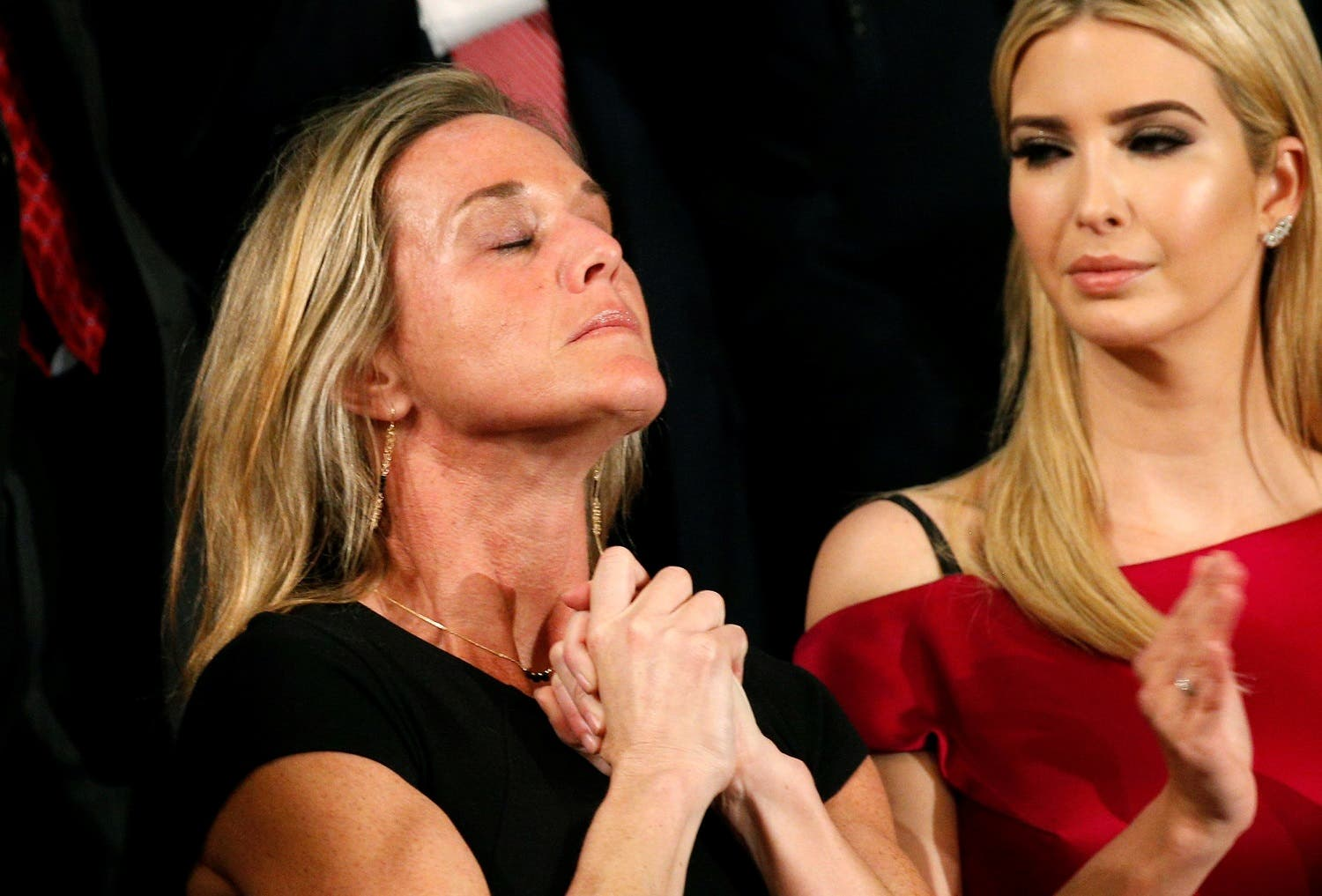 """Carryn Owens, widow of Senior Chief Petty Officer William """"Ryan"""" Owens who was killed during a raid in Yemen, applauds with Ivanka Trump (R), daughter of U.S. President Donald Trump, after being mentioned by the president (Photo: Reuters/Kevin Lamarque)"""