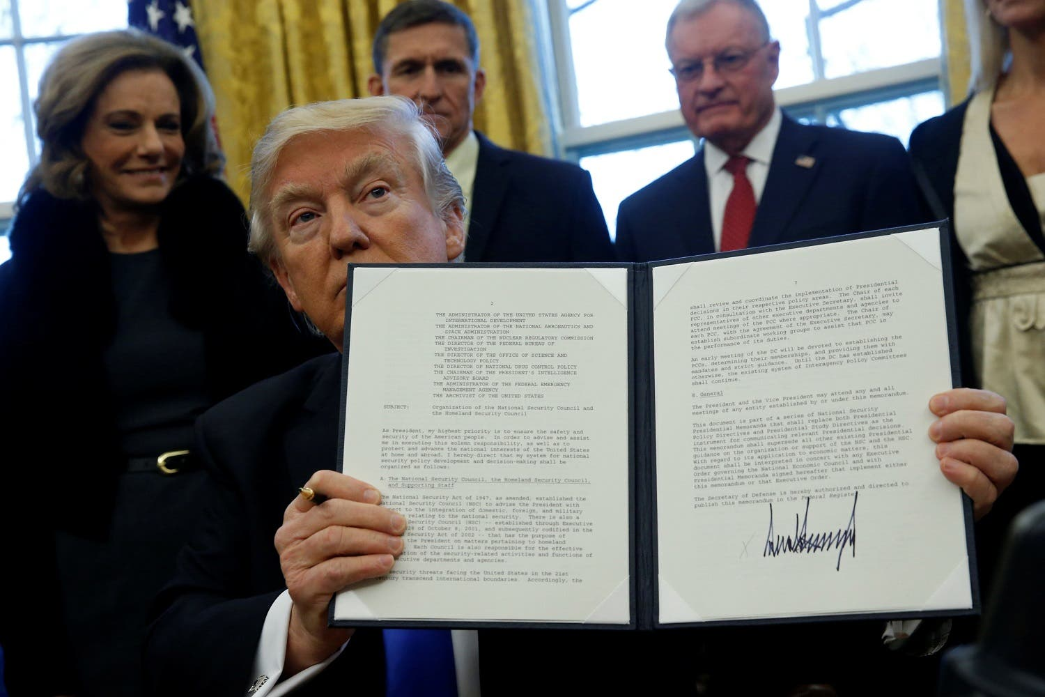 Trump holds an executive order dealing with the structure of the National Security Council after signing it in the Oval Office at the White House in Washington, US January 28, 2017 – his 100 days have seen him signing a number of executive orders (Photo: Reuters/Jonathan Ernst)