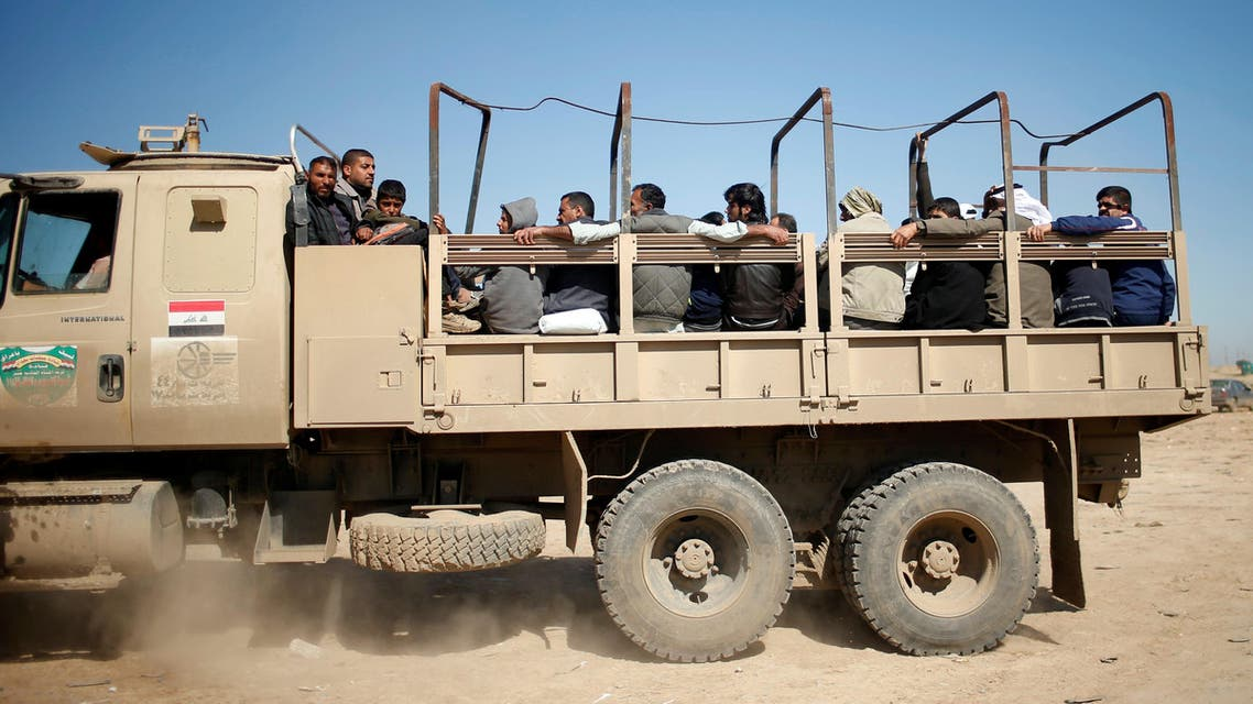 Displaced Iraqis flee their homes as Iraqi forces battle with ISIS militants, in western Mosul, Iraq March 25, 2017. (Reuters)
