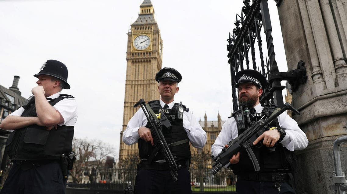 Armed police stand outside the Houses of Parliament in London, Britain March 28, 2017 REUTERS/Neil Hall