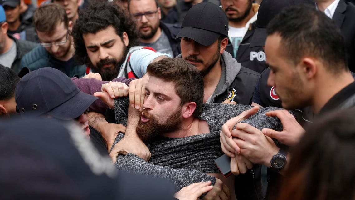 Police arrest a demonstrator during a May Day protest in Istanbul