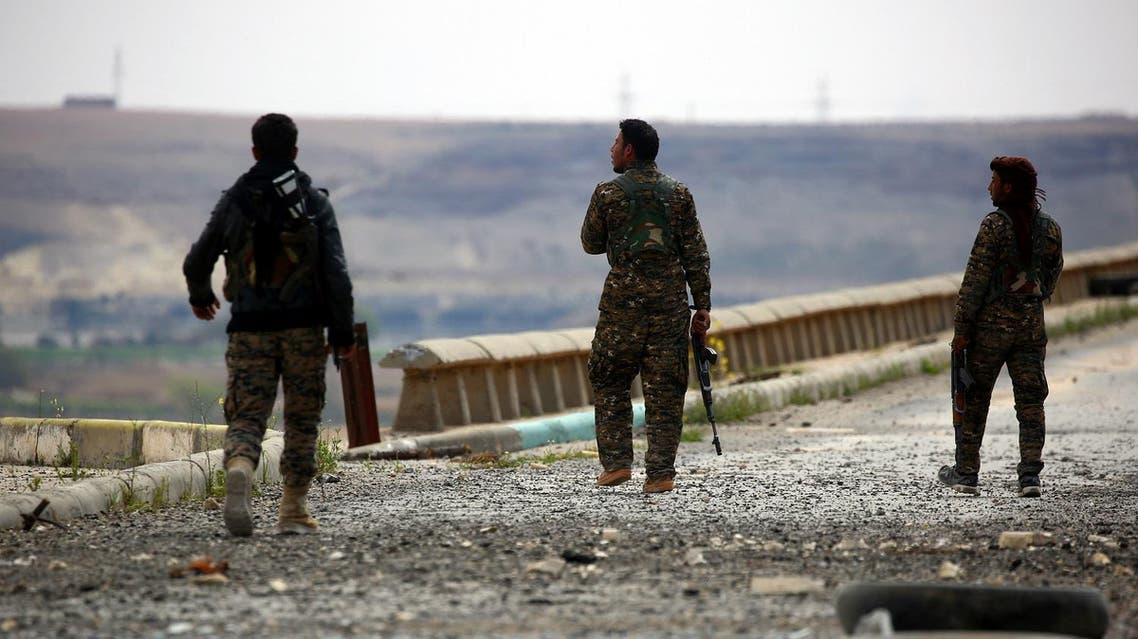 Members of the US-backed Syrian Democratic Forces (SDF), made up of an alliance of Arab and Kurdish fighters, inspect the Tabqa dam on March 27, 2017, which has been recently partially recaptured, as part of their battle for the jihadists' stronghold in nearby Raqa. US-backed Syrian fighters paused their offensive on a key dam held by the Islamic State group to allow a technical team to enter the complex, a spokeswoman said. AFP
