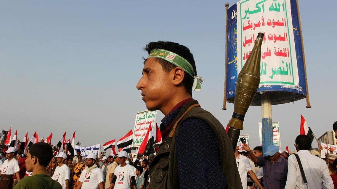 "A Houthi militant stands guard at the site of a rally held to show support to the Houthi rebels and their allies and also to denounce preparations by the Yemeni government and its Arab allies to launch an assault on the port city according to the organisers, in the Red Sea port city of Hodeidah, Yemen, April 6, 2017. The poster reads, ""Allah is the greatest. Death to America, death to Israel, a curse on the Jews, victory to Islam"". REUTERS/Abduljabbar Zeyad"