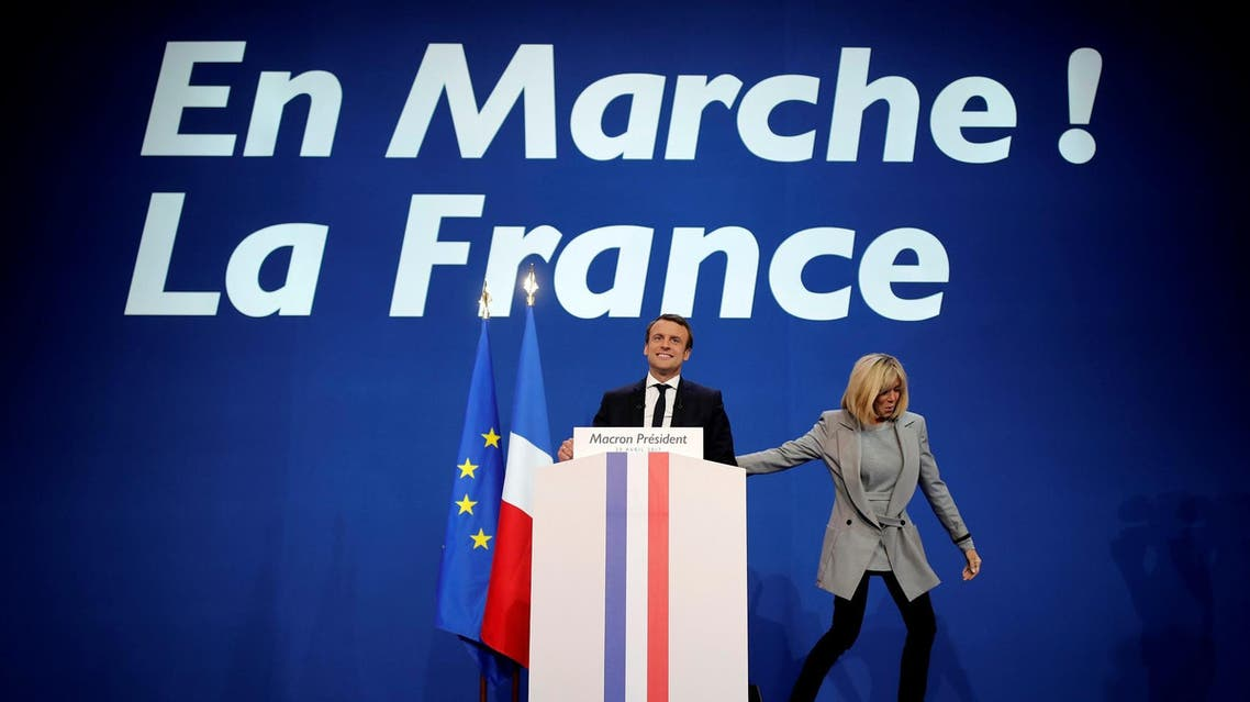 Emmanuel Macron, head of the political movement En Marche !, or Onwards !, and candidate for the 2017 French presidential election, arrives on stage with his wife Brigitte Trogneux. (Reuters)