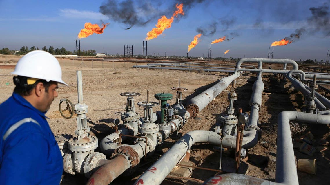 An Iraqi worker worker prepares to operate valves in Nihran Bin Omar field north of Basra, 340 miles (550 kilometers) southeast of Baghdad, Iraq, Thursday, Jan. 12, 2017. Iraq's state-run South Gas Company inaugurated a gas pipeline to transport gas, a by-product of oil production, from Nihran Bin Omar field to the national network. (AP Photo/ Nabil al-Jurani)