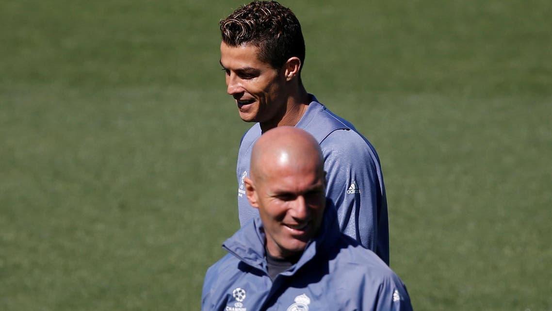 Real Madrid's coach Zinedine Zidane and Cristiano Ronaldo attend a training session. reuters