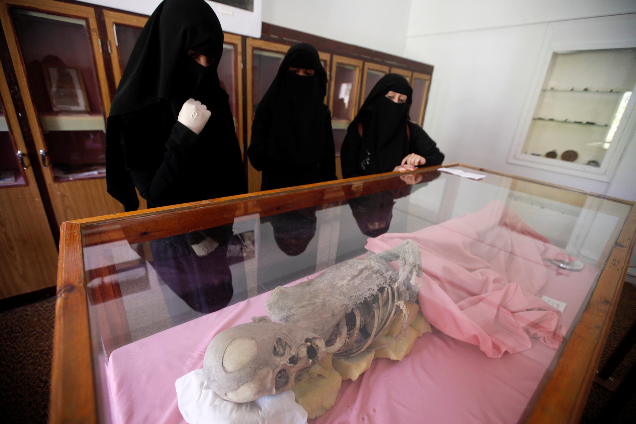 Women look at a mummy dating back to an ancient Yemen era displayed at a museum at Sanaa University, in Sanaa, Yemen April 29, 2017. reuters