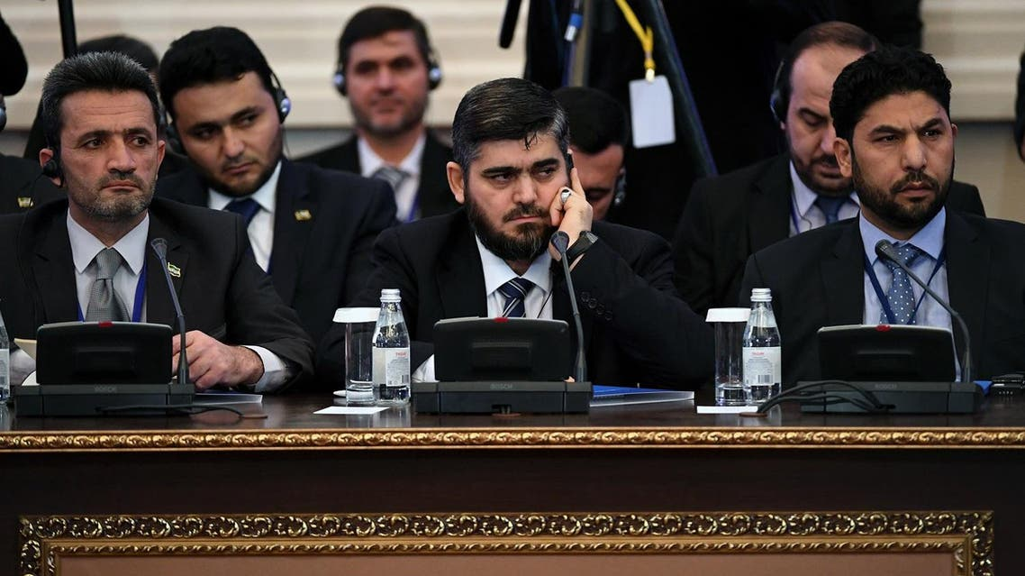 (FILES) This file photo taken on January 23, 2017 shows chief opposition negotiator Mohammad Alloush (C) of the Jaish al-Islam (Army of Islam) rebel group attending the first session of Syria peace talks at Astana's Rixos President Hotel. A Syrian rebel delegation has arrived in the Kazakh capital Astana for Russian-led talks aimed at ending the country's civil war after the group snubbed the previous round, Kazakhstan said on May 2. (AFP)