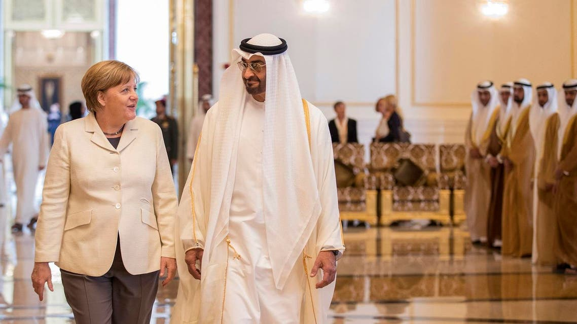 German chancellor Angela Merkel, left, is received by Crown Prince of Abu Dhabi and Deputy Supreme Commander of the UAE Armed Forces Sheikh Mohammed bin Zayed al-Nahayan in Abu Dhabi, United Arab Emirates. (AP)
