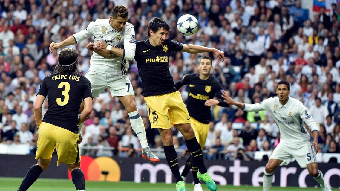 Real Madrid's Portuguese forward Cristiano Ronaldo (2ndL) heads to score during the UEFA Champions League semifinal first leg football match Real Madrid CF vs Club Atletico de Madrid at the Santiago Bernabeu stadium in Madrid, on May 2, 2017. AFP