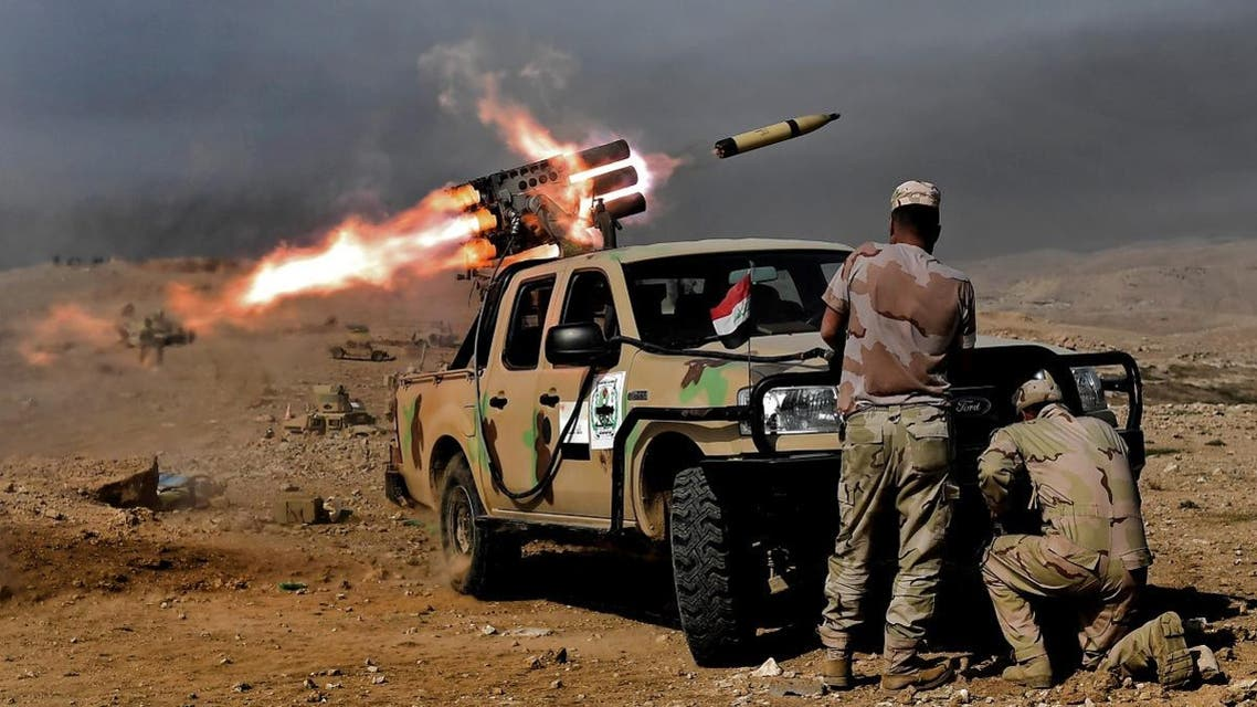 Members of the Iraqi army's 9th Division fire a multiple rocket launcher from a hill in Talul al-Atshana, on the southwestern outskirts of Mosul, on February 27, 2017. (AFP)