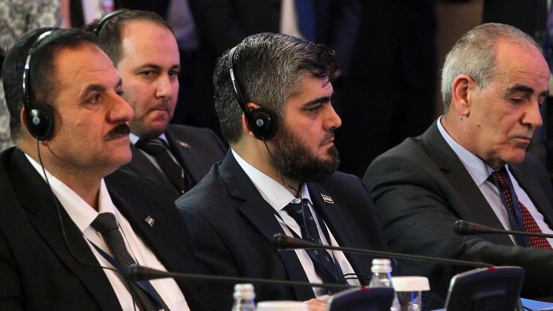 Chief opposition negotiator Mohammad Alloush (C) of the Jaish al-Islam (Army of Islam) looks on during the second session of Syria peace talks at the Rixos President Hotel in Astana, on February 16, 2017. (AFP)