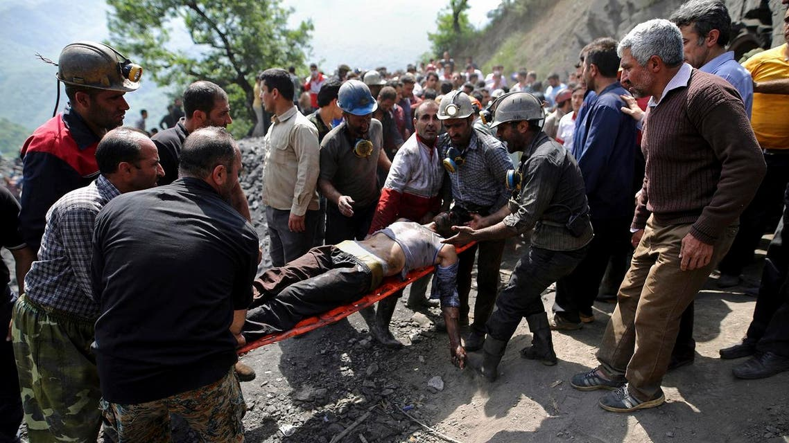 miners and rescue personnel carry an injured mine worker after a coal mine explosion, near Azadshahr in northern Iran, Wednesday, May, 3, 2017. (AP)