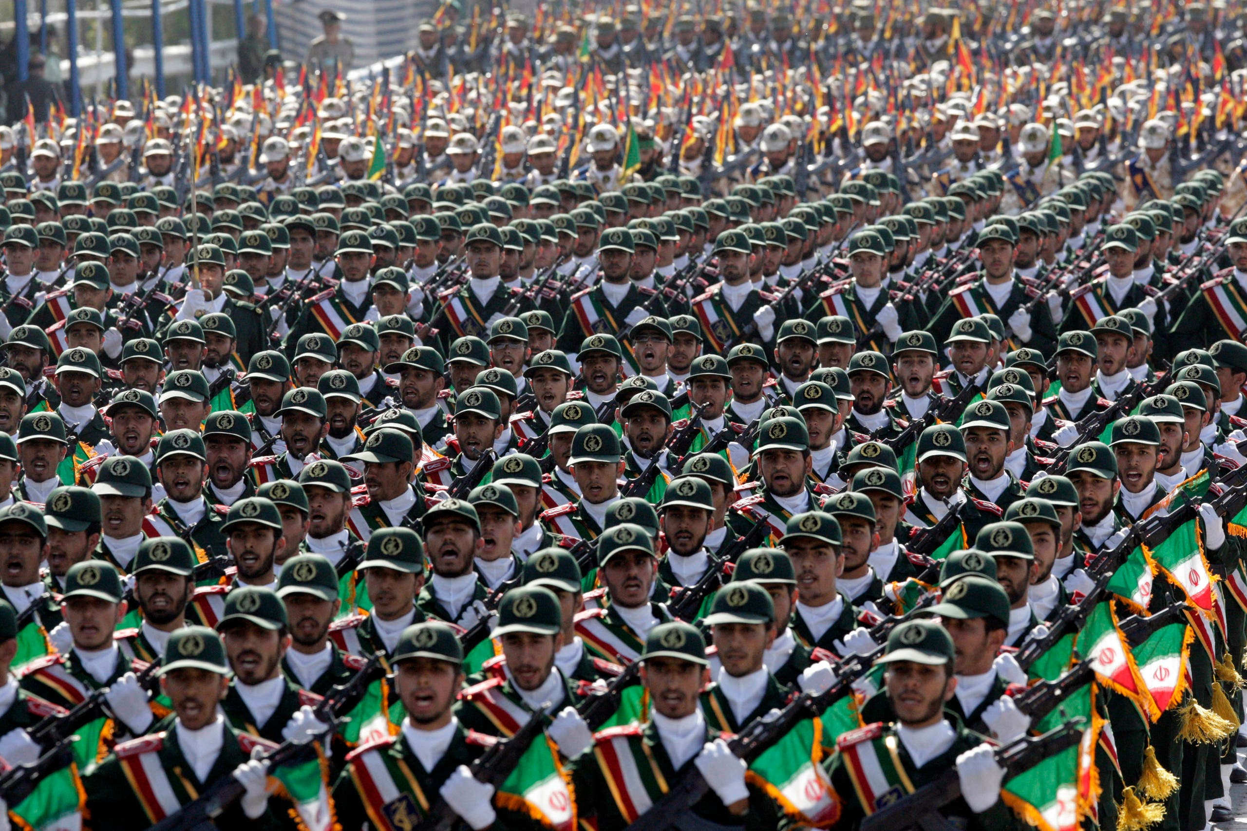 Iran's Revolutionary Guard troops march, during a military parade commemorating the start of the Iraq-Iran war 32 years ago, in front of the mausoleum of the late revolutionary leader Ayatollah Khomeini, just outside Tehran, Iran, Friday, Sept. 21, 2012. (AP)